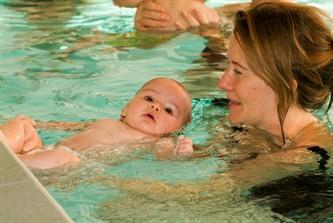 Baby Swimming With Mum